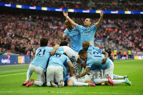 •Manchester City players celebrating a goal