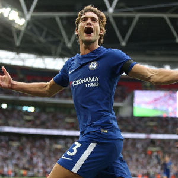 •Match hero Marcos Alonso celebrates one of his two goals for Chelsea . . .on Sunday a Wembley Sta
