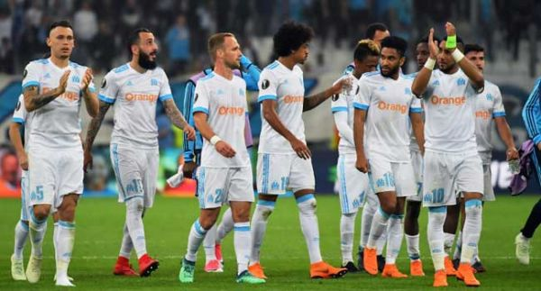 •Marseille's players celebrate their victory at the end of the UEFA Europa League