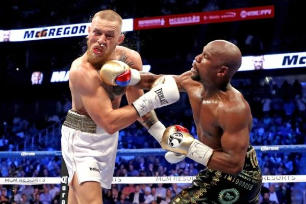 BREAKING: Mayweather knocks out McGregor in epic fight