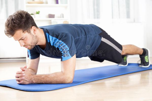 •File photo of men planking exercise