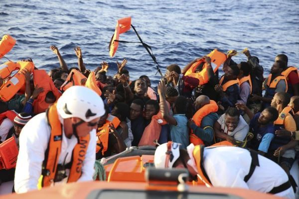 •African migrants crossing the Libya sea.