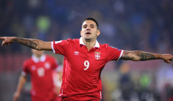 •Serbia's two-goal hero Aleksandar Mitrovic in celebration mode