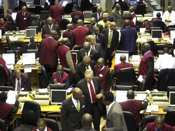•Stock traders on the floor the NSE