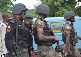 •Nigeria police on duty