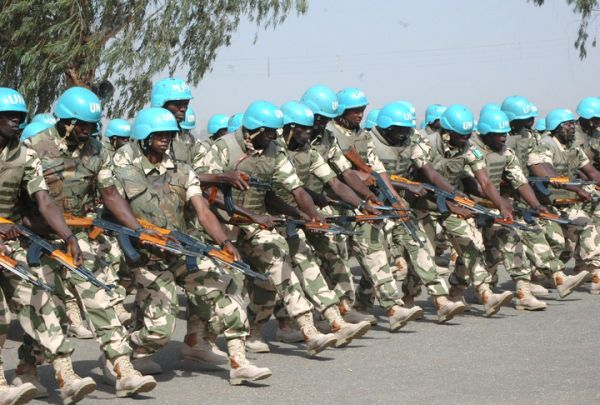 •Nigerian soldiers warming up for deployment as UN troops.