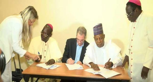 •Northern Governors and Catholic Mission officials signing the pact on Friday.