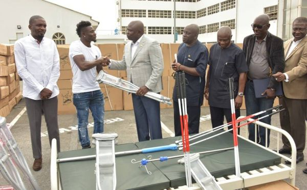 •Soccer ace Obafemi Martins shaking hands with Governor Ambode during the donation