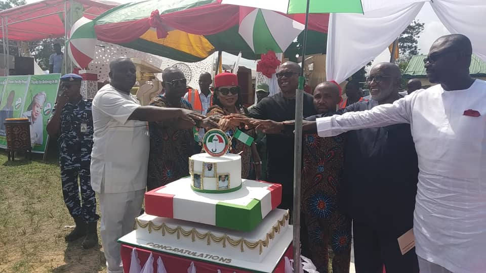 •Obi and others cutting the victory cake at the thanksgiving service . . . on Sunday