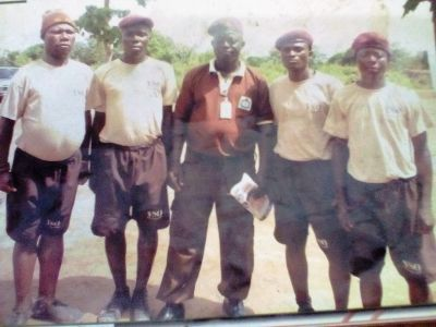 •Babatunde Lawal (victim of police detention) can be seen on the left; his boss in the middle