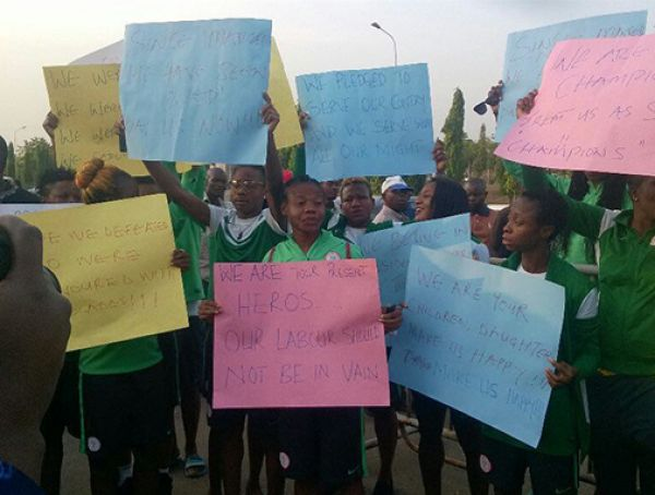 The protesting Super Falcons brandishing placards . . . on Wednesday at the National Assembly.