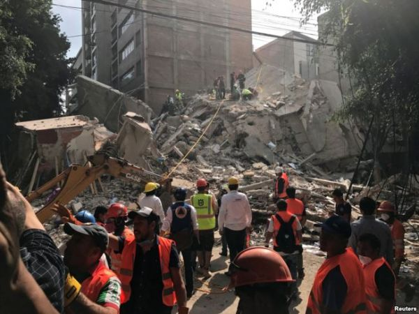 •Rescue workers at work at one of the sites of the Mexico earthquake