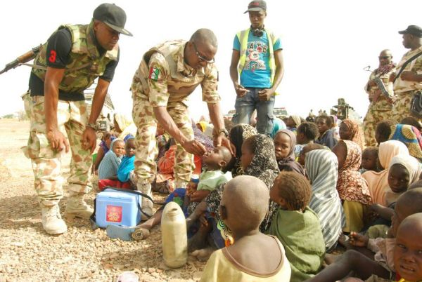 •Troops vaccinating rescued children on Friday at Ngala, Borno State.