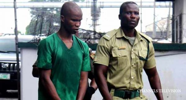 •Alleged ritual killer Ifeanyi Dike (L) after his arraignment at the Rivers State High Court, Port