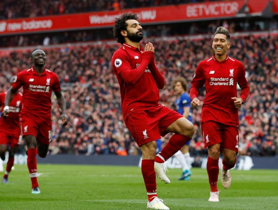 •Salah celebrating a goal for Liverpool
