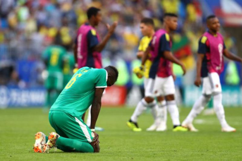 •Salif Sane of Senegal looks dejected following his sides defeat in the 2018 FIFA World Cup
