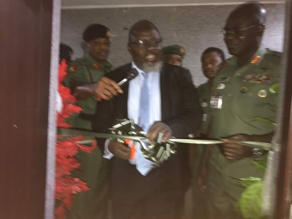 •Communication Minister Shittu cutting the tape to commission NAICC.