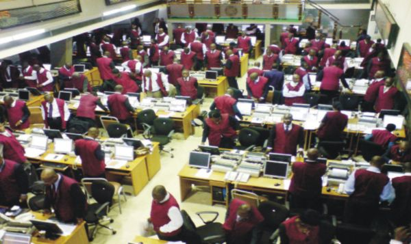 •Stock traders on the floor of the Nigerian Stock Exchange