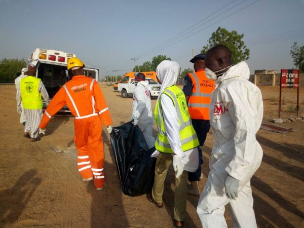 •The remains of the suicide bombers being evacuated by emergency workers.