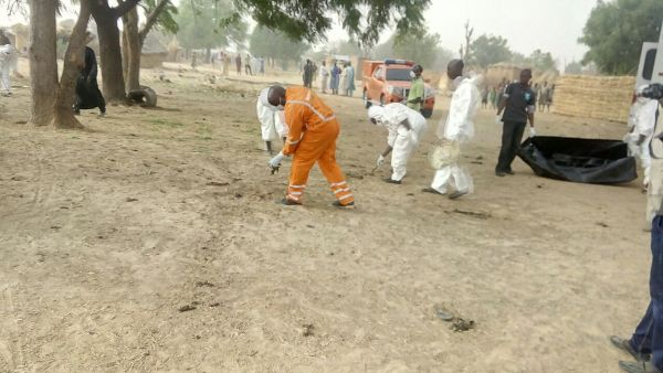 •Rescue workers at work after Saturday night's suicide bomb attacks in Borno State.