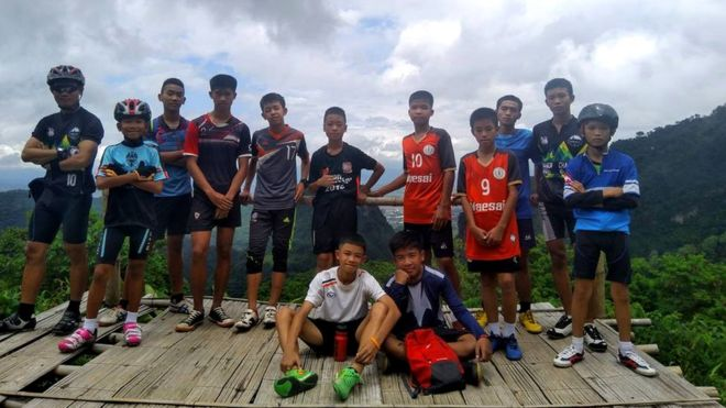 •Thailand cave rescue. Group of teenage boys with coach