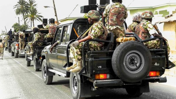 •Nigerian soldiers on the way to an operation.