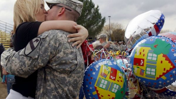 •A US soldier passionately kissing the wife
