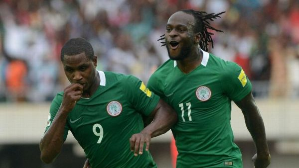 •Odion Ighalo (L) celebrating with goal scorerVictor Moses. Photo: Kabiru Abubakar/fotodezamora