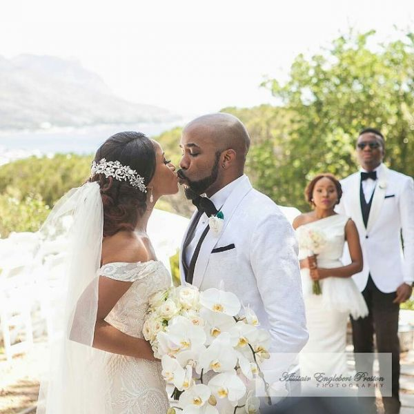 •Banky W and Adesua sealing their union with a kiss . . . yesterday in Cape Town