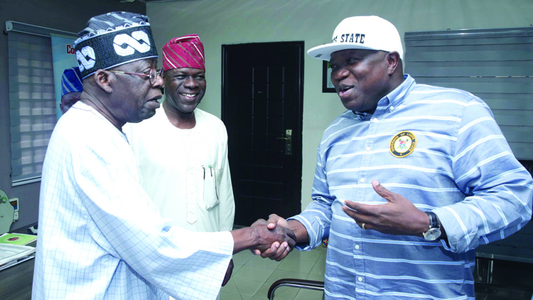 •Governor Ambode (R) exchanging pleasantries with Asiwaju Tinubu at a political event