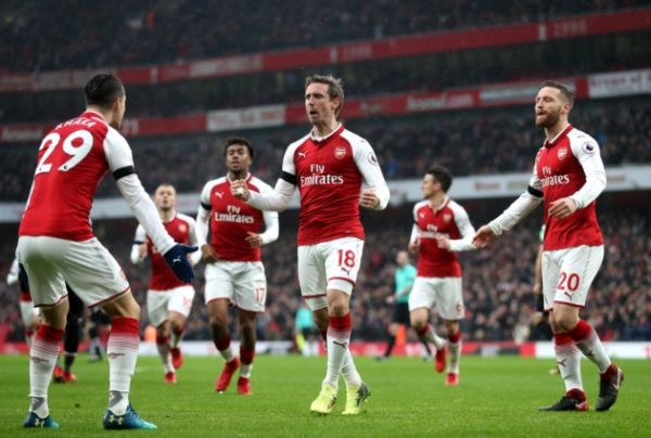 •Arsenal players celebrating Saturday's drubbing of Crystal Palace at the Emirates
