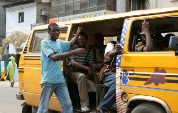 •Lagos bus conductor at work