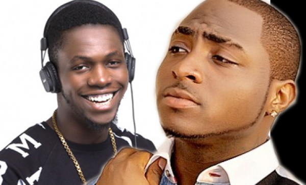 •Davido (R) and late friend, DJ Olu