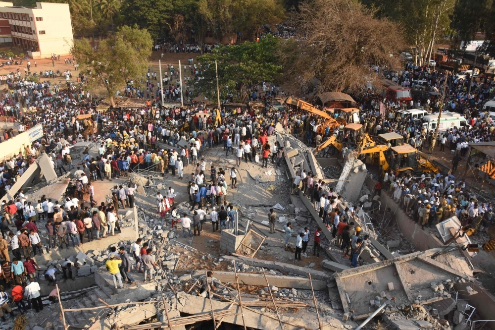 Two dead, dozens trapped, in India building collapse: Officials
