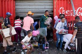 •Xenophobic South Africans looting a foreign-owned shop