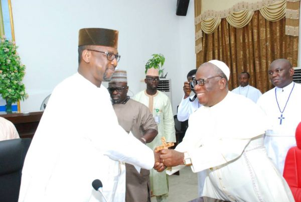 •Governor Sani-Bello and His Eminence (Dr.) Samuel Uche on Wednesday at the Governor's Office, M