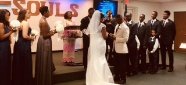 •Sarah exchanging wedding rings in Texas church wedding. Photo: US Nigeria Law Group.