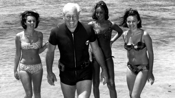 •Late Australian PM Harold Holt on the beach with his three daughters-in-law, circa 1966