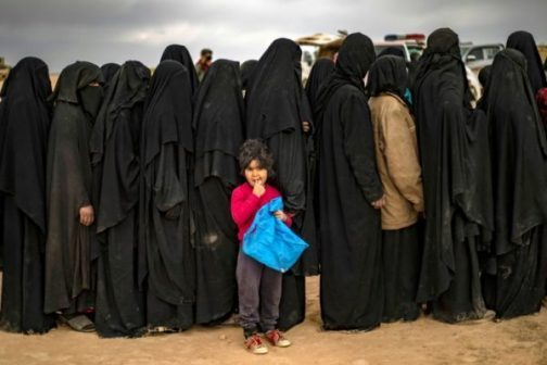 •Women queue at a screening point in Syria after fleeing Islamic State shrunk territory